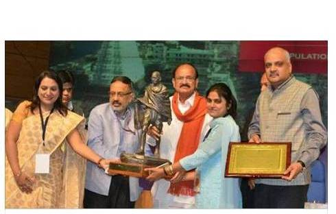 Mayor, Commissioner MCF & PS ULB receiving swachta award from Hon. Minister M Venkaiah Naidu for being India's fastest Swachhta moving city